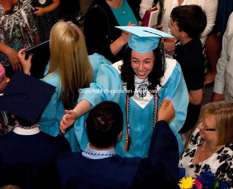OXFORD, CT 21 JUNE, 2010-062110JS14-Oxford High School graduate Jennifer Schmutiz hugs a fellow graduate following Commencement for the first graduating class at Oxford High School Monday. <br /> Jim Shannon Republican-American