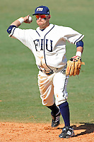 28 February 2010:  FIU's Jeremy Patton (22) throws to first as the FIU Golden Panthers defeated the Oral Roberts Golden Eagles, 7-6 (10 innings), at University Park Stadium in Miami, Florida.