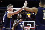 RALEIGH, NC - FEBRUARY 03: Notre Dame's Temple TJ Gibbs (10), Rex Pflueger (0), and Austin Torres (1). The North Carolina State Wolfpack hosted the University of Notre Dame Fighting Irish on February 3, 2018 at PNC Arena in Raleigh, NC in a Division I men's college basketball game. NC State won the game 76-58.