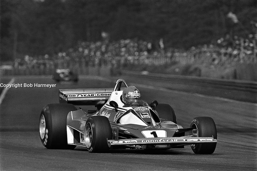 HEUSDEN-ZOLDER, BELGIUM - May 16: Niki Lauda of Austria drives the Ferrari 312T2 026/Ferrari 015 en route to victory in the Grand Prix of Belgium FIA Formula 1 race at Circuit Zolder near Heusden-Zolder, Belgium on May 16, 1976.
