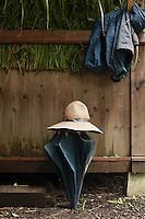 Detail on a rainy day at the Miseyama Shrine: umbrella, jacket, and hat.