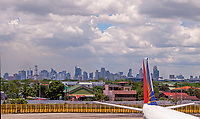 Philippine Airlines plane view from the Manila International Airport towards high rise Buildings, Philippines