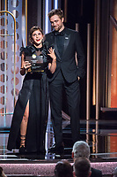 Emma Watson and Robert Pattinson present during the 75th Annual Golden Globe Awards at the Beverly Hilton in Beverly Hills, CA on Sunday, January 7, 2018.<br /> *Editorial Use Only*<br /> CAP/PLF/HFPA<br /> &copy;HFPA/PLF/Capital Pictures