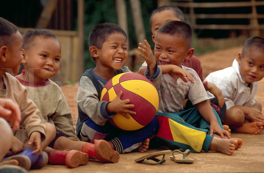 School children participate in a basketball clinic in their village in the Hill Tribe region of Northern Thailand