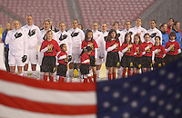 USA women sing the USA's national anthem before the Women's USA Mexico match at Rio Tinto Stadium March 31, 2010 in Salt Lake City, Utah. The USA women won the match over Mexico 1-0.