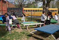 NWA Democrat-Gazette/CHARLIE KAIJO Kids search for Easter eggs during an Easter egg hunt, Friday, April 12, 2019 at the Boys and Girls Club in Rogers. <br /> <br /> The Mitchell Williams Law Firm gave the Boys and Girls club of Rogers a $15,000 grant and held an egg hunt for the kids of the club. They offer grants each year through a program called Take Time To Give. The purpose is to encourage the law staff to do charitable work said Kyle Heffley, an attorney from the firm. <br /> <br /> The Boys and Girls club has five facilities in the county serving 150-200 kids at each site. The clubs experience a lot of wear-and-tear. Contributions from community organizations help the staff to focus on serving the kids.