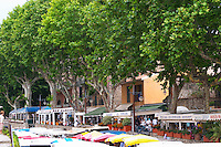 The street market and a row of cafes and restaurants under the plane trees. Collioure. Roussillon. France. Europe.
