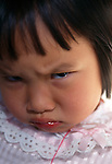 Young Asian girl with pouting look, Estes Park, CO