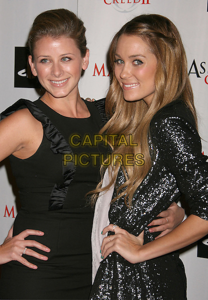 "LAUREN ""LO"" BOSWORTH & LAUREN CONRAD .at the Maxim And Ubisoft Celebrate The Launch Of 'Assassin's Creed II' held At Voyeur, West Hollywood, California, USA, 11th November 2009.half length ruffle ruffles sleeveless dress hand on hip hands hips silver sequined sequin jacket grey gray hair twisted twist smiling .CAP/ADM/MJ.©Michael Jade/AdMedia/Capital Pictures."