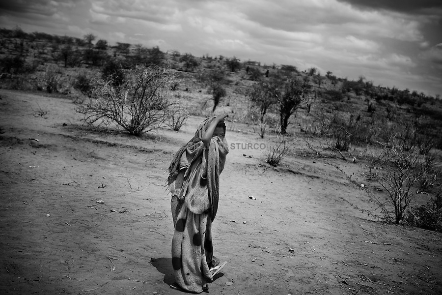 Doolow in Southern Somalia is on the frontline of an Islamic insurgency and famine now facing the Bakool and Shabelle Districts of Somalia, the most lawless nation on earth, July 2011.. Here staggering across harsh desert with meagre supplies women and children flee here on foot, walking for up to twenty days, towards the Ethiopian border where camps are already overflowing with the victims of the first famine of the 21st Century.