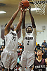 Darien Jenkins #20 of Deer Park, left, and teammate Rayshion Bien Aise #2 control the boards during a Suffolk County varsity boys basketball game against Kings Park at Deer Park High School on Friday, Jan. 6, 2017. Deer Park won by a score of 84-56.