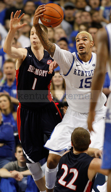 Forward Willie Cauley-Stein reached forward to grab the ball from Belmont forward Drew Windler during the second half of the University of Kentucky men's basketball game vs. Belmont University at Rupp Arena in Lexington, Ky., on Saturday, December 21, 2013. Photo by Marcus Dorsey | Staff.