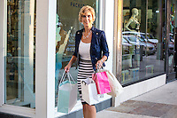 Happy female shopper with shopping bags, shopping at an Outdoor Mall in Austin, Texas.