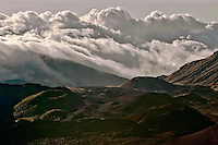 Approaching storm clouds add to the mystique of HALEAKALA NATIONAL PARK on Maui in Hawaii