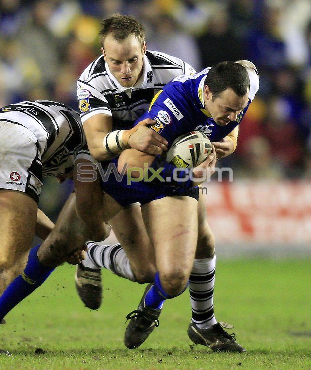 Pix: Chris Mangnall/SWpix.com, Rugby League, Super League. 08/02/08.Warrington Wolves v Hull FC....picture copyright>>simon wilkinson>>07811267 706>>....Warrington's Adrian Morley tackled by Hull's Danny Houghton and Ewan Dows