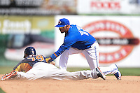 Toronto Blue Jays infielder Ryan Goins (17) attempts to tag Andrew Aplin (79) sliding into second during a Spring Training game against the Houston Astros on March 9, 2015 at Florida Auto Exchange Stadium in Dunedin, Florida.  Houston defeated Toronto 1-0.  (Mike Janes/Four Seam Images)