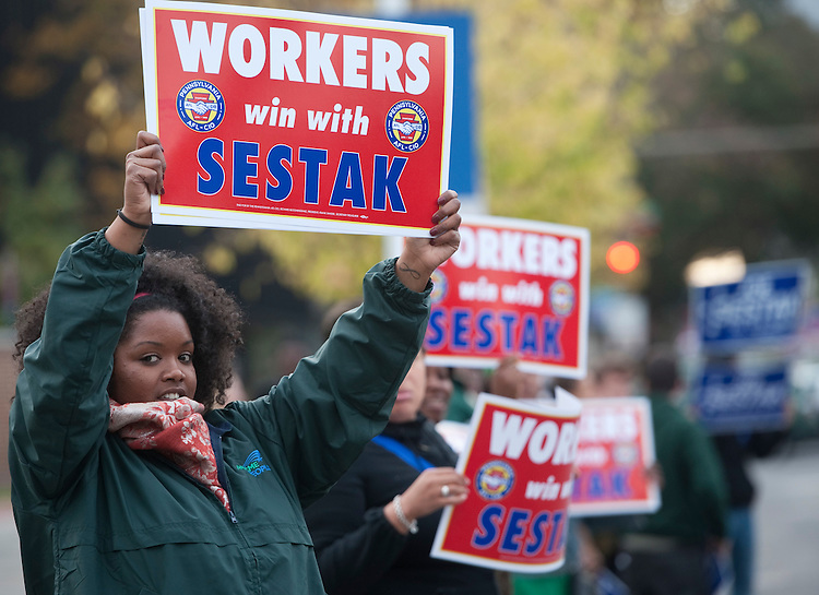 UNITED STATES - OCTOBER 20: Pat Toomey and Joe Sestak supporters wave signs at passing cars before the start of the Pennsylvania Senate debate between the two candidates in Philadelphia on Wednesday, Oct. 20, 2010. (Photo By Bill Clark/Roll Call via Getty Images)