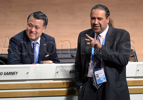 26.02.2016. Zurich, Switzerland.  FIFA Executive Committee Members Kohzo Tashima (L) and Sheikh Ahmad al Fahad al Sabah share a smile during the Extraordinary FIFA Congress with the president's election at the Hallenstadion in Zurich, Switzerland, 26 February 2016.