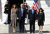 United States President Donald J. Trump (2nd,L), first lady Melania Trump (L), Vice President Mike Pence (2nd,R) and his wife Karen stand at the South Portico as they arrive to join White House staff for a moment of silence on the South Lawn of the White House, Washington, DC, for the mass shooting in Las Vegas, Nevada, October 2, 2017.                  <br /> Credit: Mike Theiler / CNP