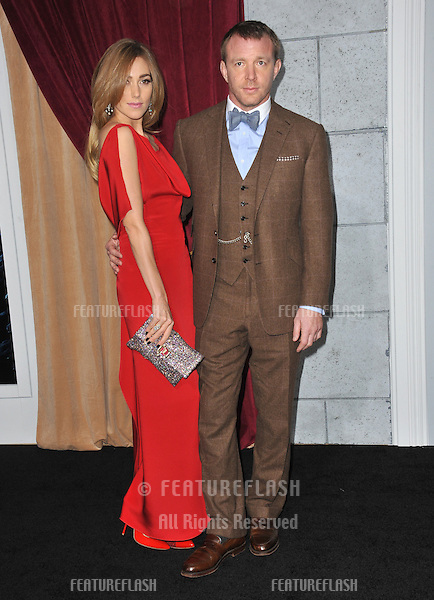 "Director Guy Ritchie & Jacqui Ainsley at the Los Angeles premiere of his new movie ""Sherlock Holmes: A Game of Shadows"" at the Village Theatre, Westwood..December 6, 2011  Los Angeles, CA.Picture: Paul Smith / Featureflash"