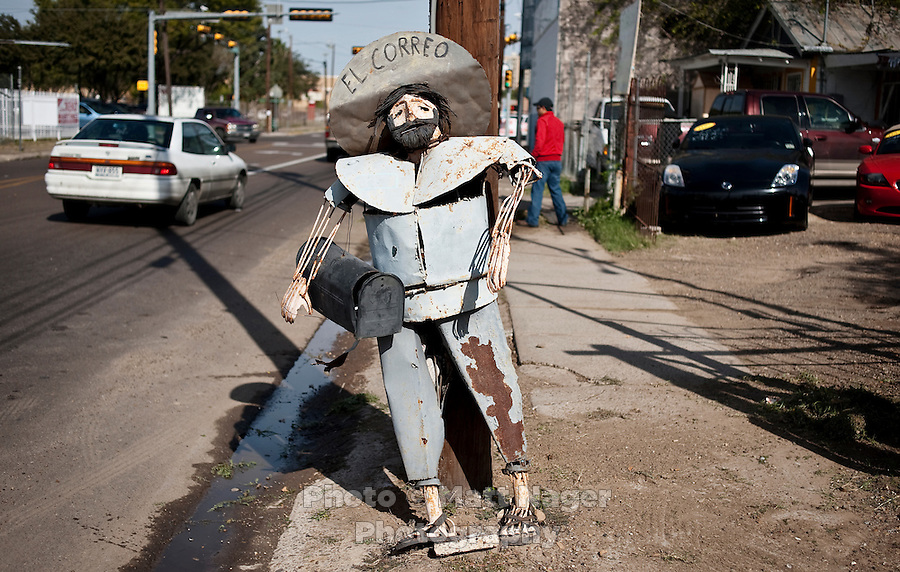 A sculpture of a Mexican holding a mailbox in West Laredo, Texas, Tuesday, Dec., 8, 2009. ..PHOTOS/ MATT NAGER