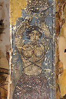 Fresco on the underside of an arch in the hall at Qasr Amra, Jordan. This fresco depicts a woman wearing a sarong and holding a plate above her head. These early Islamic frescoes have strong Persian and Byzantine influences. The original castle complex was built in 723-743 by Walid Ibn Yazid, the future Umayyad Caliph Walid II. It was a fortress with military garrison and residence of the Umayyad Caliphs. Today only the royal pleasure cabin remains, with reception hall and hammam or bath house. Picture by Manuel Cohen