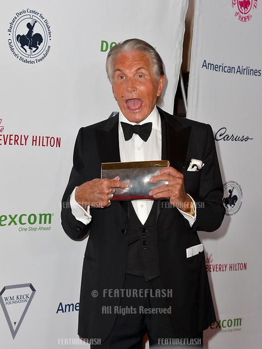 LOS ANGELES, CA. October 06, 2018: George Hamilton at the 2018 Carousel of Hope Ball at the Beverly Hilton Hotel.<br /> Picture: Paul Smith/Featureflash