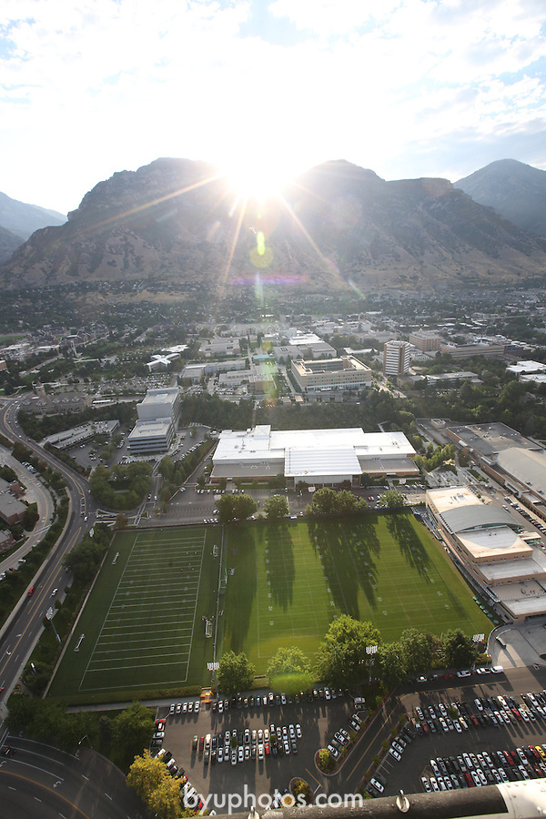 1309-22 0059<br /> <br /> 1309-22 BYU Campus Aerials<br /> <br /> West looking East, Provo, Sunrise, Richards Building Fields RBF, Practice Fields, Richards Building RB<br /> <br /> September 6, 2013<br /> <br /> Photo by Jaren Wilkey/BYU<br /> <br /> &copy; BYU PHOTO 2013<br /> All Rights Reserved<br /> photo@byu.edu  (801)422-7322