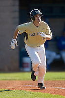 Austin Stadler #9 of the Wake Forest Demon Deacons watches the flight of his 2-run home run versus the Duke Blue Devils at Jack Coombs Field March 29, 2009 in Durham, North Carolina. (Photo by Brian Westerholt / Four Seam Images)