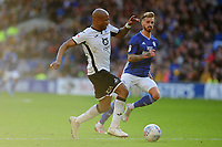 Andre Ayew of Swansea City vies for possession with Joe Bennett of Cardiff City during the Sky Bet Championship match between Cardiff City and Swansea City at the Cardiff City Stadium in Cardiff, Wales, UK. Sunday 12 January 2020