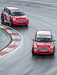 Durabond Team Octane drivers P.J. Groenke and Andre Rapone  speed their Mini Cooper  car during the CTCC official practice race ahead the F1 Grand Prix du Canada at the Circuit Gilles-Villeneuve on June 08, 2012 in Montreal, Canada. Photo by Victor Fraile / The Power of Sport Images
