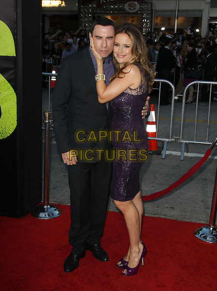 John Travolta and Kelly Preston.The World Premiere of 'Savages' held at The Grauman's Chinese Theatre in Hollywood, California, USA..June 25th, 2012.full length suit dress married husband wife lace purple black side hand on face cheek .CAP/ADM/KB.©Kevan Brooks/AdMedia/Capital Pictures.