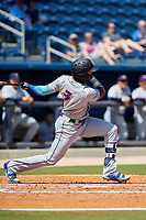 Jacksonville Jumbo Shrimp center fielder Monte Harrison (3) follows through on a swing during a game against the Biloxi Shuckers on May 6, 2018 at MGM Park in Biloxi, Mississippi.  Biloxi defeated Jacksonville 6-5.  (Mike Janes/Four Seam Images)