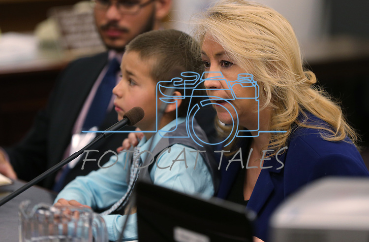 Elvira Diaz and her son Christian Arroyo, 8, testify in support of a bill that would include transgender people on the list of protected identites in Nevada's hate crime statue, during a committee hearing at the Nevada Legislature in Carson City, Nev., on Monday, March 4, 2013..Photo by Cathleen Allison