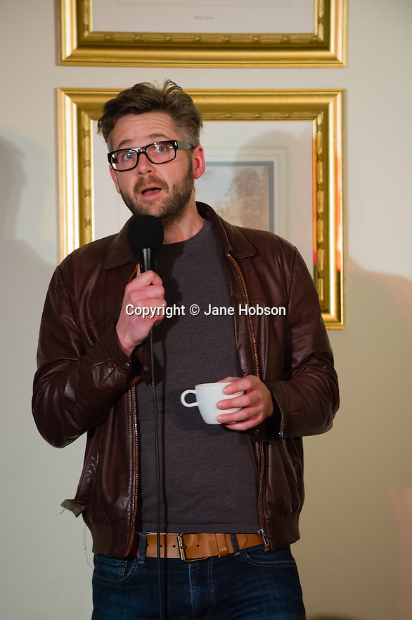 Harrogate, UK. 12/04/2012. Standing room only as Sitting Room comedy, yet again, packs out the function room at the St George Hotel, Harrogate.  Featuring M.C. Tom Taylor, Carey Marx, James Redmond (Abs from Casualty) and Rob Rouse, headlining. Picture shows Rob Rouse. Photo credit: Jane Hobson