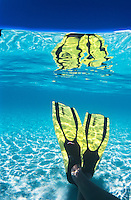 Snorkel fins and reflection<br /> Clear Caribbean water<br /> St. John<br /> U.S. Virgin Islands