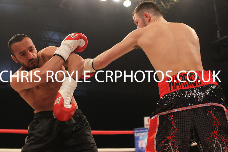 Isaac Lowe  vs Ibrar Riyaz in a boxing contest at the Ponds Forge Arena, Sheffield, Yorkshire, promoted by Hennessy Sports - 23/03/14 - MANDATORY CREDIT: Chris Royle/TGSPHOTO -