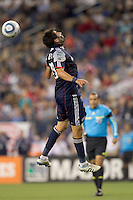 New England Revolution midfielder Monsef Zerka (19) heads the ball. In a Major League Soccer (MLS) match, the New England Revolution defeated FC Dallas, 2-0, at Gillette Stadium on September 10, 2011.