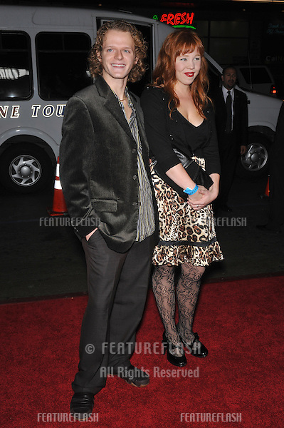 "Nick Pasqual & Angie Hoppen at the AFI Fest gala screening of his new movie ""The Road"" at Grauman's Chinese Theatre, Hollywood..November 4, 2009  Los Angeles, CA.Picture: Paul Smith / Featureflash"