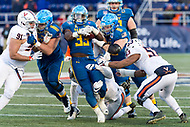 Annapolis, MD - DEC 28, 2017: Navy Midshipmen fullback Chris High (33) carries Virginia Cavaliers defenders for extra yardage during game between Virginia and Navy at the Military Bowl presented by Northrop Grunman at Navy-Marine Corps Memorial Stadium Annapolis, MD. (Photo by Phil Peters/Media Images International)