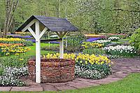 Wishing well in garden, Keukenhof Gardens, Lisse, Netherlands, Holland