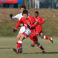 St. Lawrence midfielder Mark Provost (8) attempts to control the ball as Amherst midfielder Max Fikke (15) pressures. NCAA Division III Sectionals. In double-overtime, Amherst College (white) defeated St. Lawrence University (red), 2-1, on Hitchcock Field at Amherst College on November 23, 2013.
