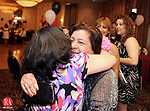 WATERBURY,  CT, 13 MAY 2012-051312JS14- Mela Power gets  a hug from her daughter Rosa Alejandro of Newark, NJ during the Mela Power  Family Reunion Sunday at the CoCo Key resort in Waterbury. Nearly 200 people from all over the country came to celebrate family on Mothers Day. Power has 21 children, 60 grandchildren, 121 great-grandchildren and 6 great-great grandchildren. .Jim Shannon Republican-American