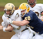 SIOUX FALLS, SD - NOVEMBER 16:  Charlie Kern #7 from Southwest Minnesota State is brought down on a sack by Joel Slinden #50 from Augustana in the first quarter of their game Saturday at Augustana. (Photo by Dave Eggen/Inertia)