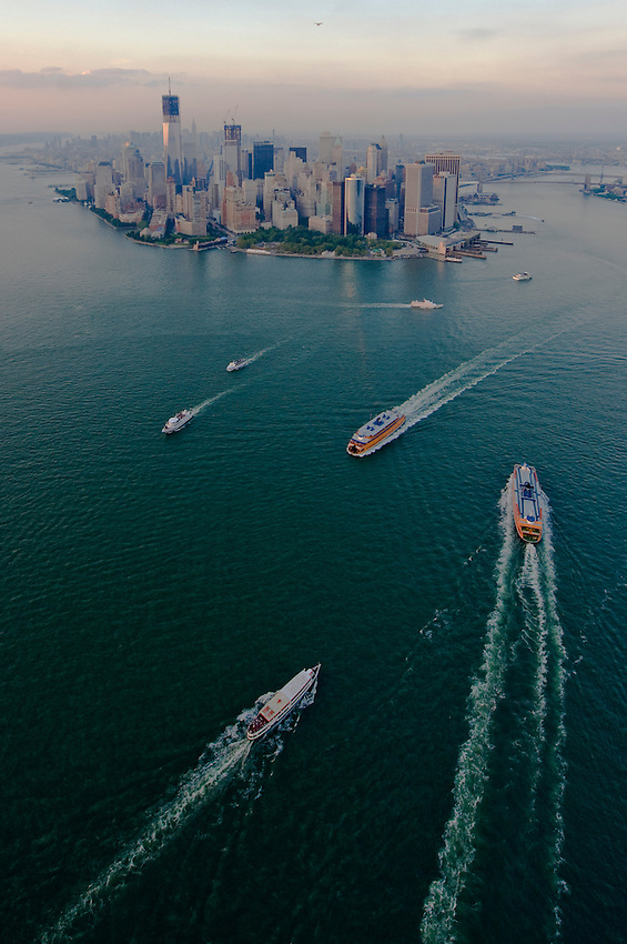 Aerial view of the Staten Island Ferry and Circle Line boats in the New York Harbor, with lower Manhattan skyline.