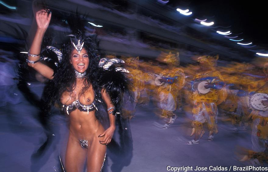 Samba Schools Parade, Carnival, Rio de Janeiro, Brazil. Carnival dancers -  Rainha de bateria ( drum queen ) topless sensual woman dancing, happiness, festival, celebration, sensuality, costumes, percussion instruments, musical instruments, vibrant dancing, energy.