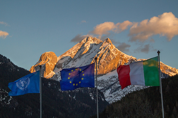 Italian and EU flags with Mt Marmolada, Canazei, Italy. .  John offers private photo tours in Denver, Boulder and throughout Colorado, USA.  Year-round. .  John offers private photo tours in Denver, Boulder and throughout Colorado. Year-round.