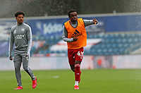 Steven Sessegnon of Fulham and Sylvester Jasper of Fulham avoiding the sprinklers as they finish warming up during Queens Park Rangers vs Fulham, Sky Bet EFL Championship Football at the Kiyan Prince Foundation Stadium on 30th June 2020