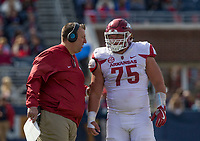 Hawgs Illustrated/BEN GOFF <br /> Bret Bielema, Arkansas head coach, talks with center Zach Rogers in the second quarter against Ole Miss Saturday, Oct. 28, 2017, at Vaught-Hemingway Stadium in Oxford, Miss.