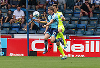 Dayle Southwell of Wycombe Wanderers and Luke Prosser of Colchester United during the Sky Bet League 2 match between Wycombe Wanderers and Colchester United at Adams Park, High Wycombe, England on 27 August 2016. Photo by Liam McAvoy.